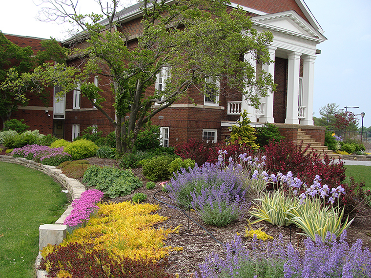 Transforming Bay Village City Hall front lawn into a colorful landscape.